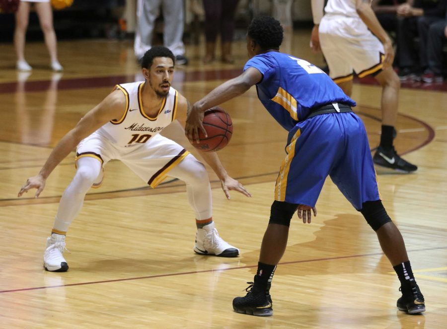 Trey Kennedy, psychology senior, guards a St. Mary's Texas Univeristy player during the game in D.L. Ligon Coliseum, Monday, Jan. 29, 2018. Photo by Rachel Johnson