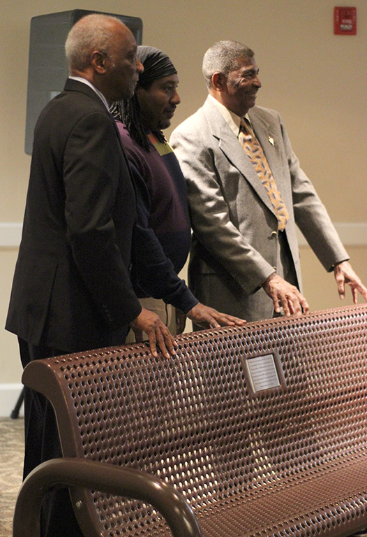 Edwin Fuller, honoree, Wynell Jenkins, honoree representative, and Charles Bosley, honoree, stand behind the bench that was dedicated to them in honor of the history they made, being apart of the first group of African Americans to attend MSU, while people take pictures in Clark Student Center Comanche Room, Friday Feb. 23, 2018. Photo by Rachel Johnson