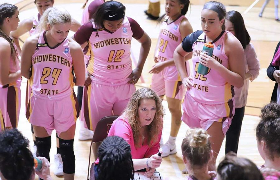 Head coach Noel Johnson speaks to her athletes in a timeout against Cameron University. Feb 20. Photo by Bridget Reilly