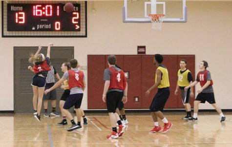 Jaren Parker, education sophomore, shoots three-pointer for her team during the co-ed intramural games at the Wellness Center on Monday, Feb. 12, 2018. Photo by Makayla Scheck