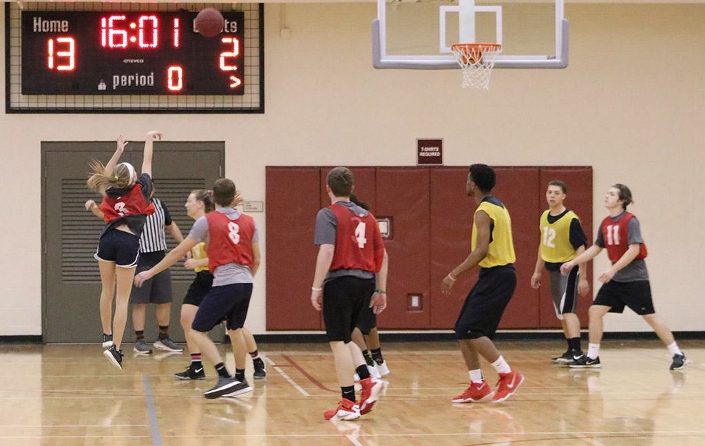 Students participate in intramural basketball