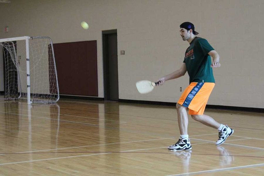 During the first intramural Pickleball tournament, Neo Krtolica, finance senior, sets to return the ball on Friday, Feb. 16, 2018 at the Redwine Wellness Center. Photo by Cortney Wood