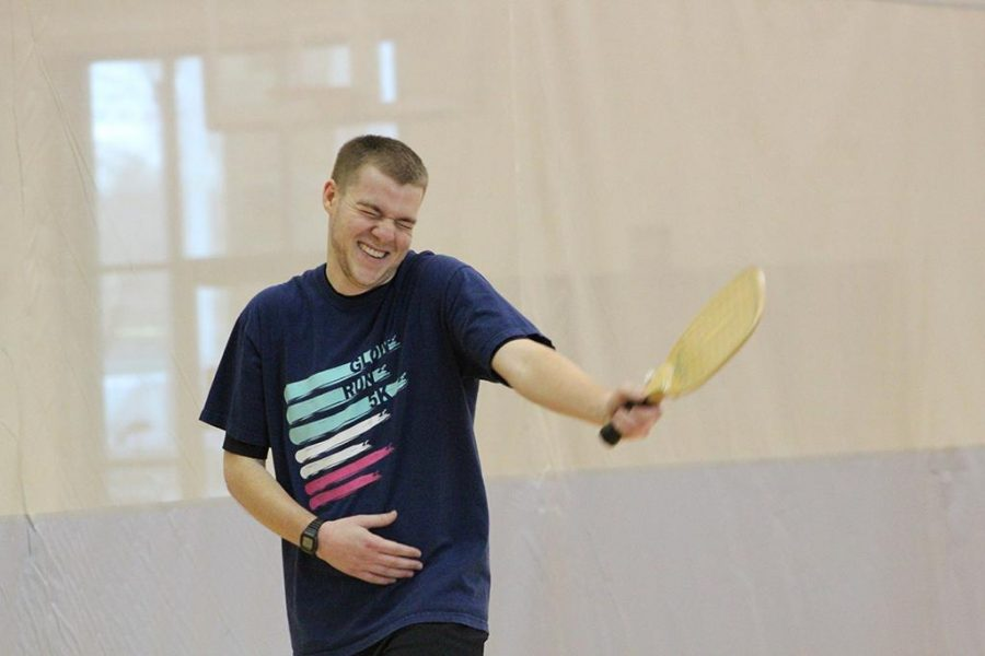 As the opposing team misses the ball, Mike Richardson, Redwine Student Wellness Center assistant director, laughs during the first intramural Pickleball tournament on Friday, Feb. 16, 2018. Photo by Cortney Wood