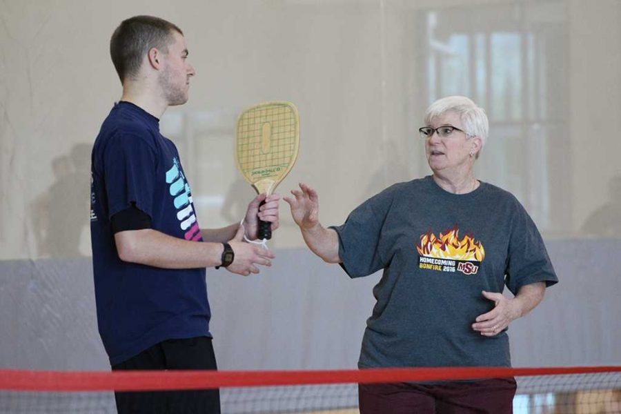 Before the first intramural Pickleball tournament on campus, Sandy Shawver, assistant professor of kinesiology, and Mike Richardson, Redwine Student Wellness Center assiastant director, review the rules and scoring on Friday, Feb. 16, 2018. Photo by Cortney Wood