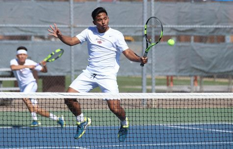 Dillon Pineda, biology junior, returns the ball back to the opponents side of the courts during Collin College vs. MSU tennis doubles meet at MSU on Friday, Feb. 9, 2018. Photo by Francisco Martinez
