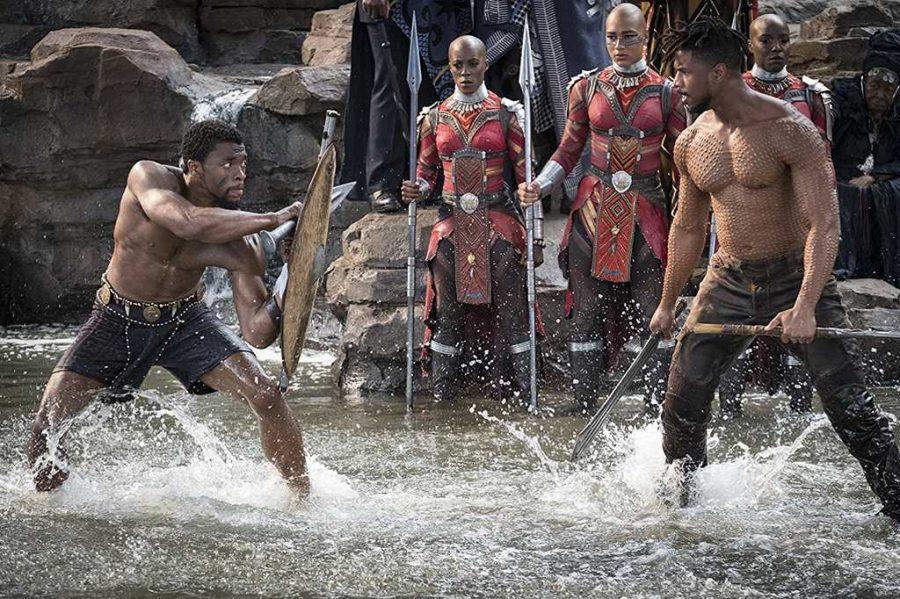 Michael B. Jordan, Chadwick Boseman, and Janeshia Adams-Ginyard in Black Panther (2018)