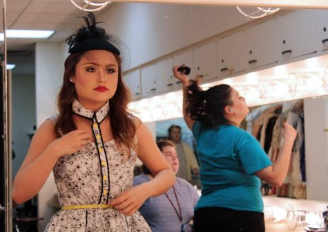 Ilka Megee, theater education sophomore, putting her makeup on before going on first run-through. Megee portays