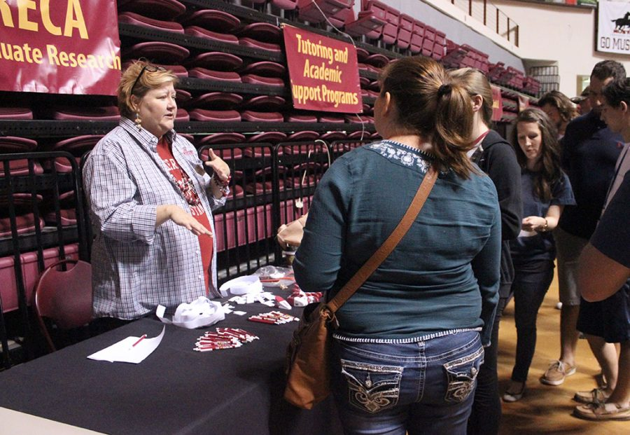 Julie Scales, secretary for undergraduate research, talks to prospective students about E.U.R.E.C.A. and the undergrad research programs they offer students at MSU, along with the benefits the program has on students that take on the opportunity, during the organization fair part of Mustangs Rally, Saturday, March 24, 2018. Photo by Rachel Johnson