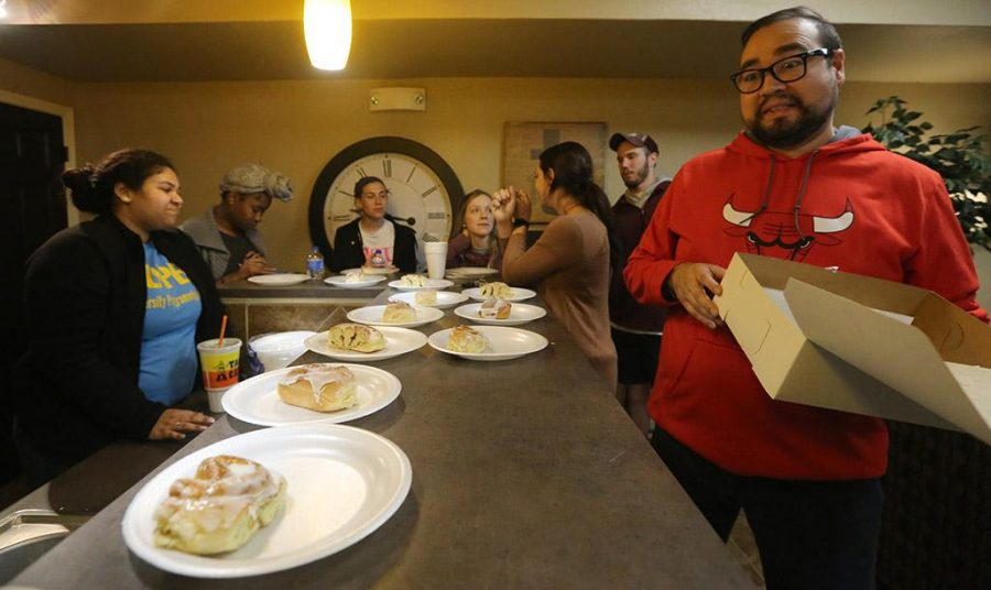 Claudio Rodriguez,  complex coordinator, is excited at the sight of a cinnamon roll during the Late Night Breakfast at Sundance community kitchen on Tuesday, March 6, 2018. Photo by Francisco Martinez