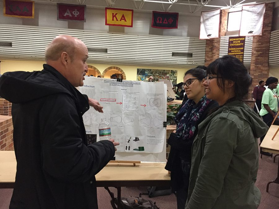 Mechanical engineering senior, Zeltzin Reyes and mechanical engineering junior, Abigail Reyes present their research to associate professor of engineering, Jan Brink at EURECA in the Atrium on March 28. Photo by Brittni Vilandre