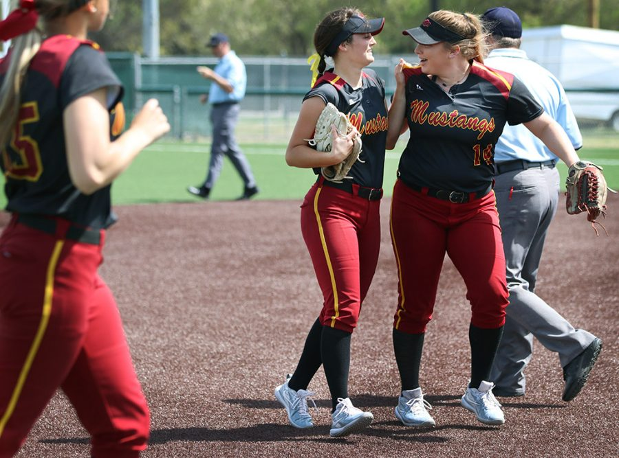 Caycee Griffin, biology freshman, and Taylor Brintzenhoff, first base senior, hold onto each other with excitement after running a play that got two players out from West Texas A&M , making three outs for WTAMU, putting MSU up to bat, Saturday, March 24, 2018. Photo by Rachel Johnson
