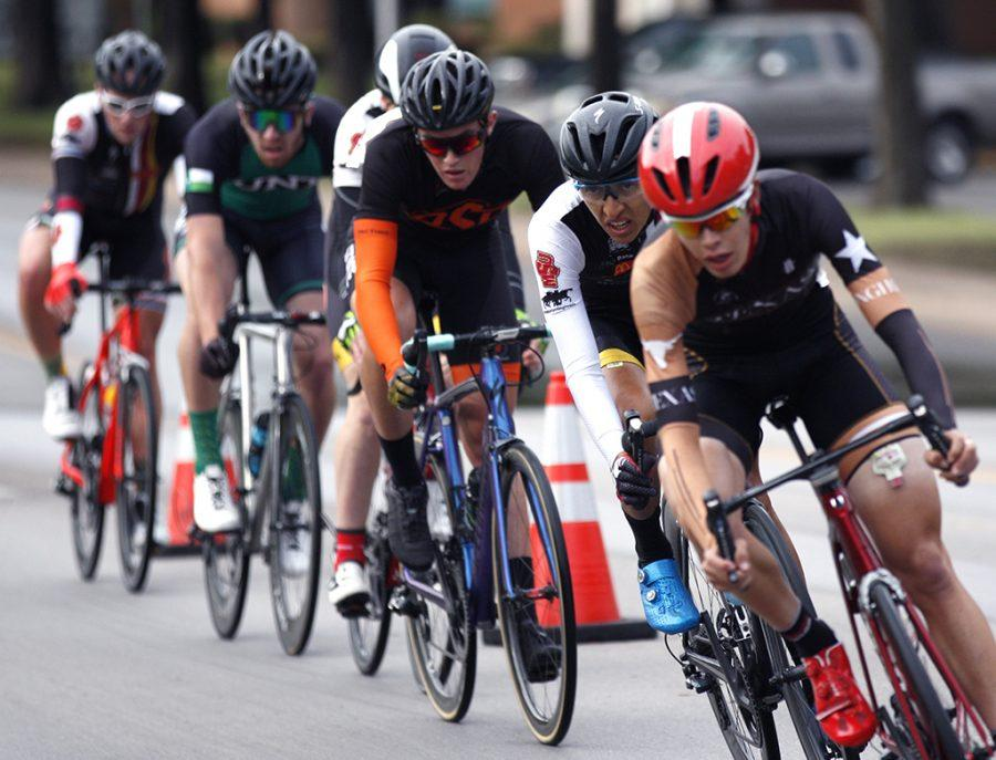 Pablo Cruz, exercise physiology senior, races during the Men's A category at the campus criterium around MSU campus on April 21, 2018. Photo by Justin Marquart