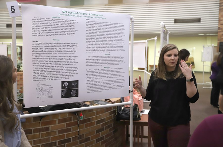 Emily Stewart, radiology junior, explains her groups research poster to students at the Undergraduate Research Endeavors and Creatiuve Activies forum in CSC Atrium on April 26, 2018.