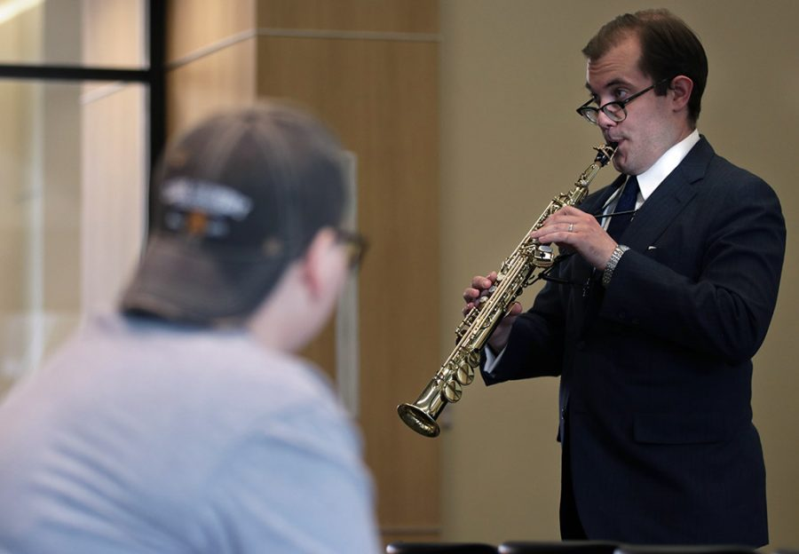 Andrew Allen, assistant music professor, sings through the saxophone while playing during the Faculty Forum Series at Legacy Hall on Tuesday, April 17, 2018. Photo by Francisco Martinez