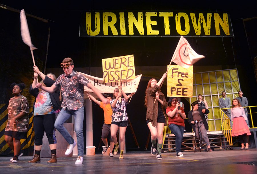 Cast members run through act I finale during rehearsal for Urinetown Thursday, Feb. 15, 2018. Photo by Robin Reid