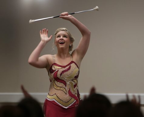 Alexis Maggard, special needs education sophomore, twirls batons during the talent portion of the Greek Week Pageant in Comanche suites on Monday, April 9, 2018. Photo by Francisco Martinez