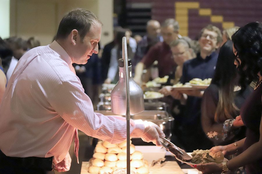 Chartwell employees serve dinner at the Honors Banquet on Friday, April 20, 2018. Photo by Brendan Wynne