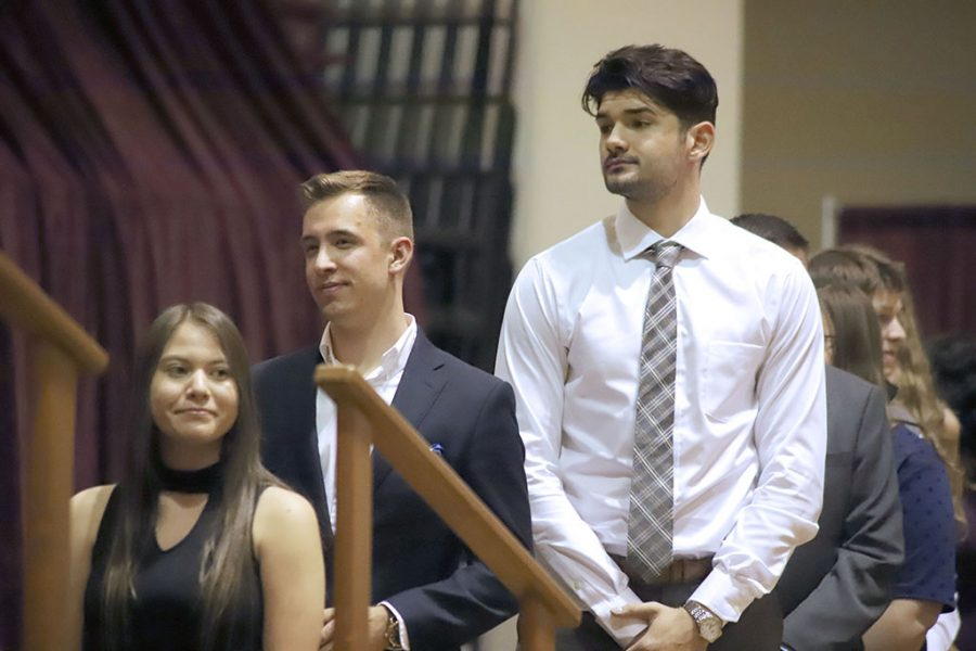 As the ceremony continues, Veronica Balderas, Luka Gebel, and Neo Krtolica, wait to receive Outstanding awards from their colleges at the Honors Banquet on Friday, April 20, 2018. Photo by Cortney Wood