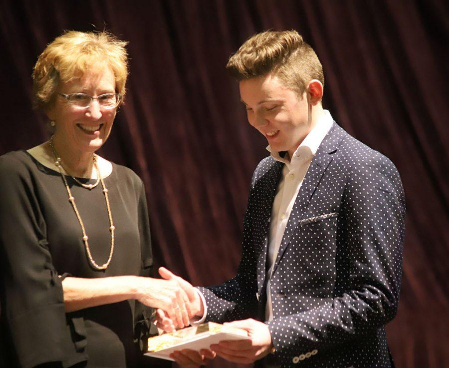 Suzanne Shipley, university president, awards Brendan Wynne, mass communication junior, the Clark Scholar award at the Honors Banquet on Friday, April 20, 2018. Clark Scholar is the second highest honor awarded to a student on campus for their work ethic, grade point average and community involvement. Photo by Cortney Wood