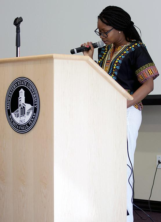 Kornika Degannes, finance senior, speaks at Immigration Stories in Legacy Multipurpose Room about her experience at Midwestern State University as Caribbean student on Tuesday, April 3, 2018. Photo by Francisco Martinez