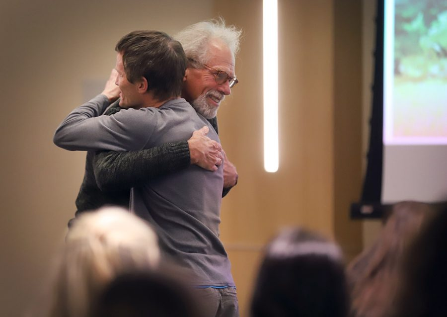 Frank Wyatt, exercise physiology professor, hugs Steve Hilton, ceramics professor, at the end of Midwestern State University's final Last Lecture Series in Legacy Multipurpose Room, April 9, 2018. Photo by Rachel Johnson