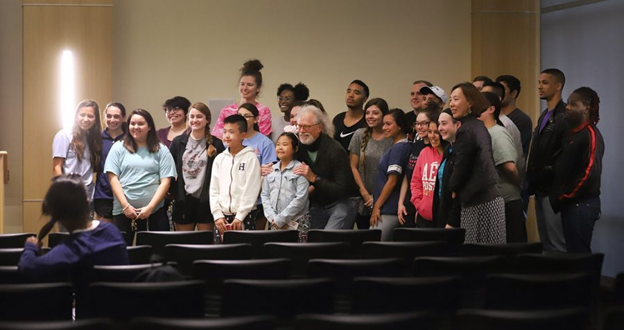 Frank Wyatt, exercise physiology professor, takes a group picture with almost all of the people who attended his lecture at Midwestern State University's final Last Lecture Series in Legacy Multipurpose Room, April 9, 2018. Photo by Rachel Johnson