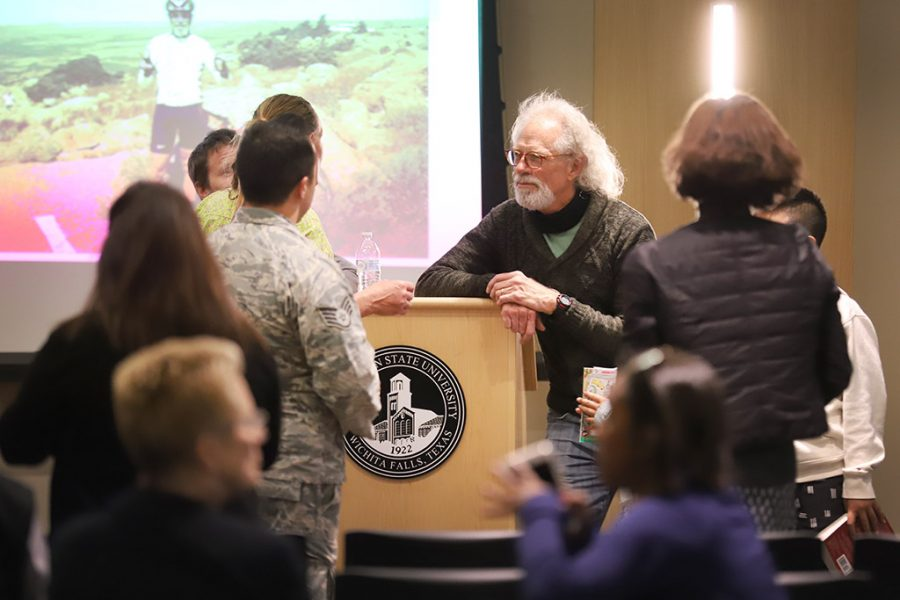 Frank Wyatt, exercise physiology professor, talks with graduated students, current students, colleagues, and other people who attended his lecture at Midwestern State University's final Last Lecture Series in Legacy Multipurpose Room, April 9, 2018. Photo by Rachel Johnson