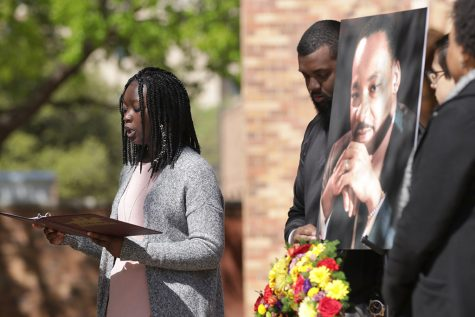 Anissa Jones, exercise physiology junior, reads life works of Martin Luther King Jr. for the 50th anniversary of the assassination of King outside of the CSC, Wednesday, April 4, 2018. Photo by Francisco Martinez