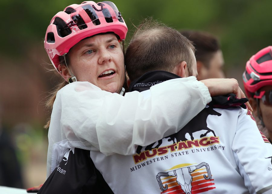 Charlie Zamastil, msu cycling team director, hugs Amy Floyd, accounting senior, after her race in the Women's A and Men's B at the 2018 Vuelta del Viento at Midwestern State University, Saturday April 21, 2018. Photo by Rachel Johnson