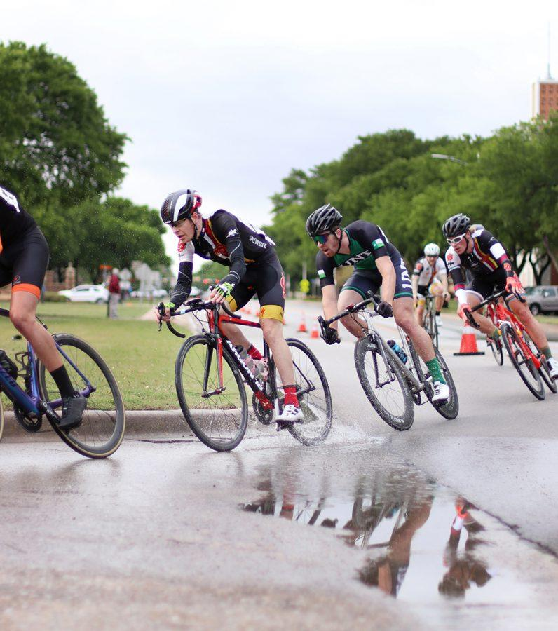 Bill Ash, finance senior, rounds the corner of Taft Blvd and Nocona Trail during the Men's A race with Joshua Buschel, accounting and finanace junior, following close behind at the 2018 Vuelta del Viento at Midwestern State University, Saturday April 21, 2018.