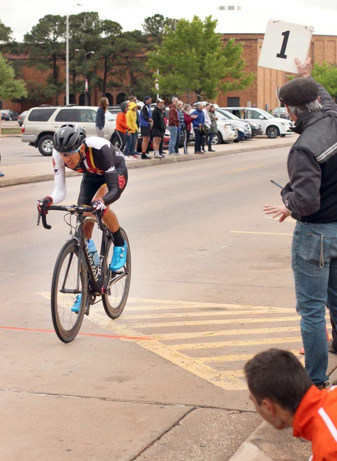 Pablo Cruz, exercise physiology senior, comes up on the finish line with one more lap to go in the Men's A race at the 2018 Vuelta del Viento at Midwestern State University, Saturday April 21, 2018. Photo by Rachel Johnson