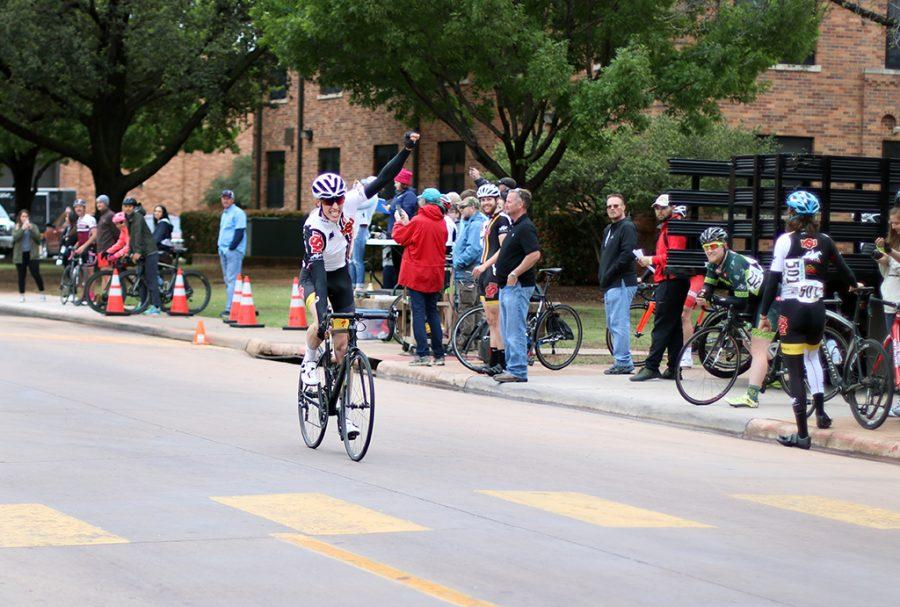 Aaron Benton, management information senior, crosses the finish line at the men's C and D placing first at the 2018 Vuelta del Viento at Midwestern State University, Saturday April 21, 2018. Photo by Rachel Johson
