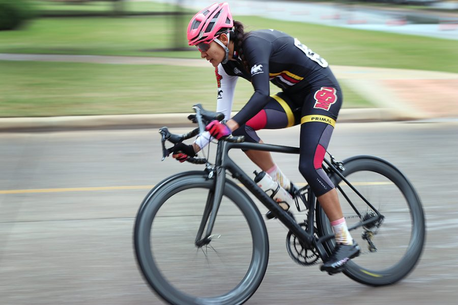 Brissia Montalvo, exercise physiology graduate, rounds the corner of Taft Blvd and Nocona Trail during one of the first couple of laps in the Women's A and Men's B race at the 2018 Vuelta del Viento at Midwestern State University, Saturday April 21, 2018. Photo by Rachel Johnson