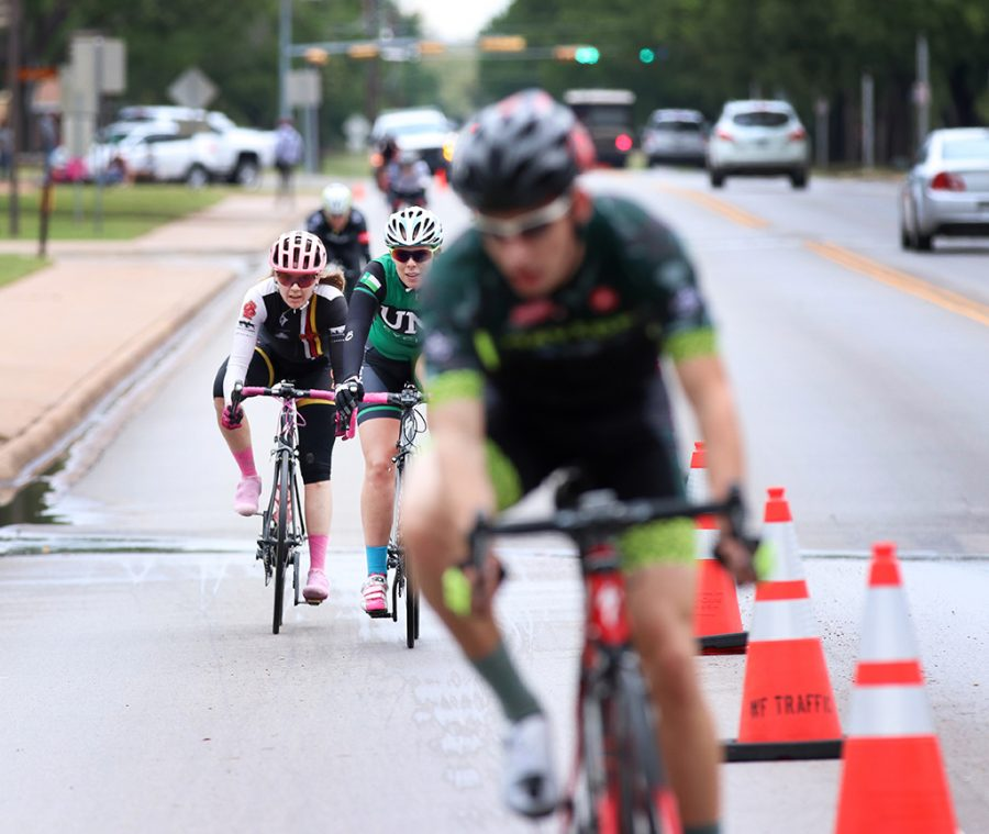 Amy Floyd, accounting senior, rides down Taft Boulevard, alongside traffic, in the Women's A and Men's B race at the 2018 Vuelta del Viento at Midwestern State University, Saturday April 21, 2018. Photo by Rachel Johnson