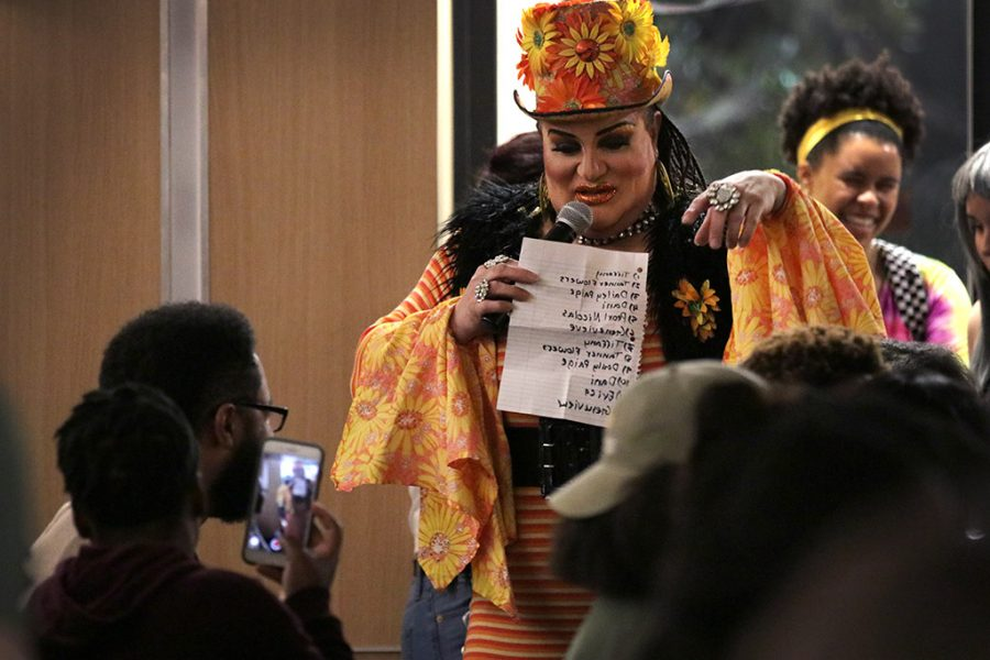 Tiffany Addams, Drag Show Host, walks around Legacy Multipurpose Room bringing different audience members into her jokes and stories that she told as she introduced each drag performer at the third annual P.R.I.D.E. Drag Show, April 5, 2018. Photo by Rachel Johnson