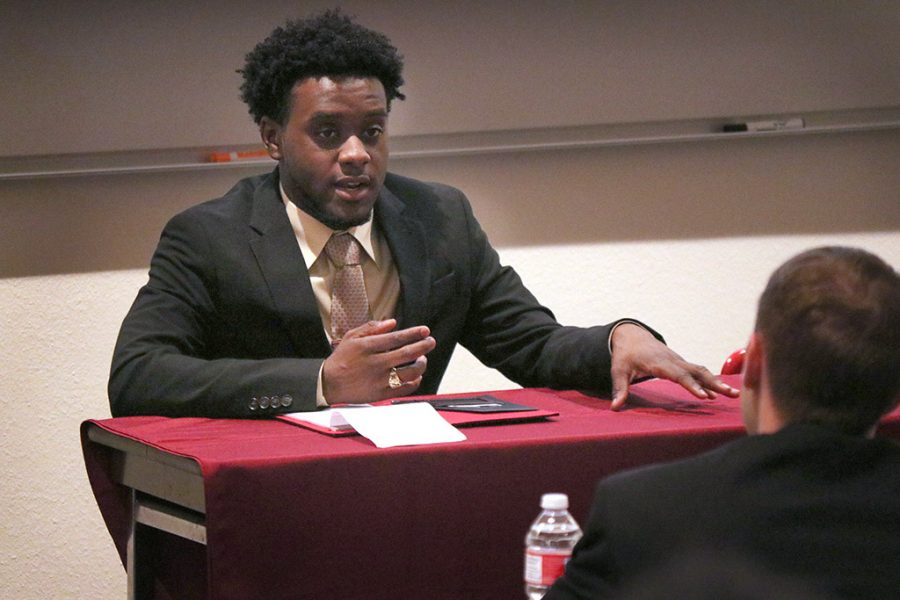 Preston Busby, criminal justice junior, speaks at the second Student Government Association debate for the 2018-2019 SGA officer candidate positions in Bolin 101, March 21, 2018. Photo by Rachel Johnson