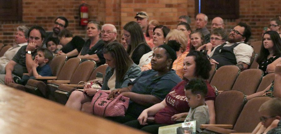 Attendees gather at Akin Auditorium to hear Scott Sampson, host and science adviser of the PBS KIDS television series Dinosaur Train, speak about,