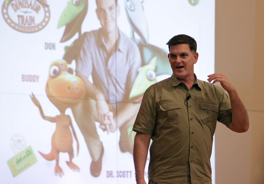Scott Sampson, host and science adviser of the PBS KIDS television series Dinosaur Train, speaks to attendees about, How to Raise a Wild Child, at Akin Auditorium on Thursday, April 12, 2018. Photo by Francisco Martinez