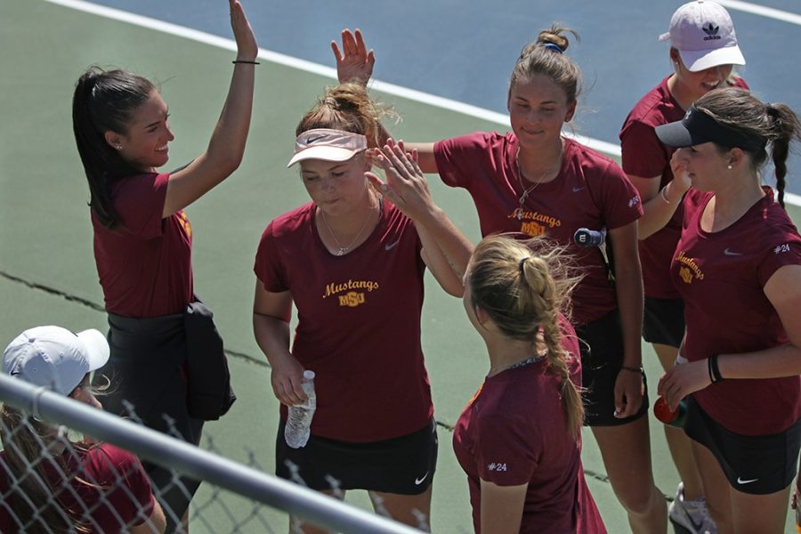 Women's Tennis team celebrates after the Cameron Unviversity vs Midwestern State University doubles tennis match at the MSU Tennis Center on Wednesday, April 11, 2018. Photo by Francisco Martinez