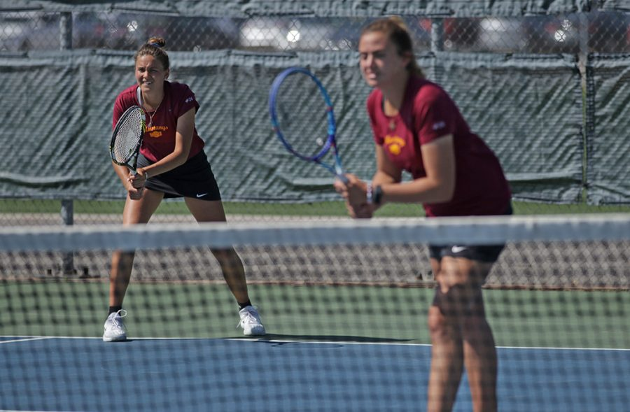 Daria Panferova, mass communications senior, and Maddie Rowe, undecided freshman, wait for a serve during the Cameron University vs Midwestern State University doubles tennis match at the MSU Tennis Center on Wednesday, April 11, 2018. Photo by Francisco Martinez