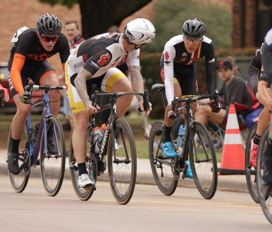 Jason Perkins, mechanical engineering junior, and Pablo Cruz, exercise physiology senior, talk strategy during the 2018 Vuelta del Viento at Midwestern State University on Saturday, April 21, 2018. Photo by Francisco Martinez