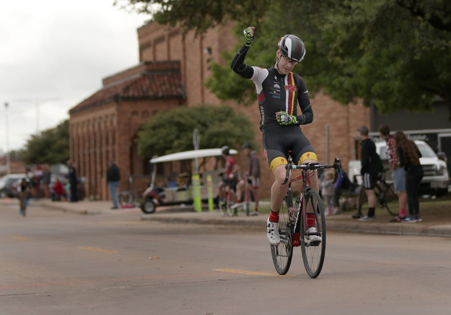Bill Ash, accounting and finance senior, passes the finish line with a fist held high during the 2018 Vuelta del Viento at Midwestern State University on Saturday, April 21, 2018. Photo by Francisco Martinez