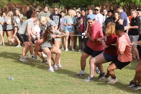 Fraternity and Sorority groups at Midwestern State University are competing in a game of tug of war during Greek Week on the Quad field on Fri. April, 13, 2018. Photo by Harlie David