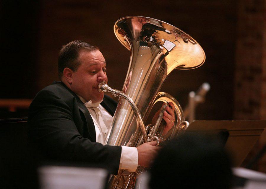 Christopher Vivio performs a tuba solo as part of the University Wind Ensemble concert April 27. Photo by Bradley Wilson