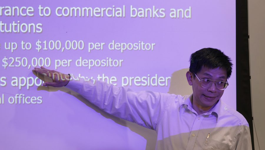 Adam Lei, Bridwell distinguished professor of finance, speaks on bank procedures on deposits and withdraws during class at Dillard on Wednesday, April 18, 2018. Photo by Francisco Martinez