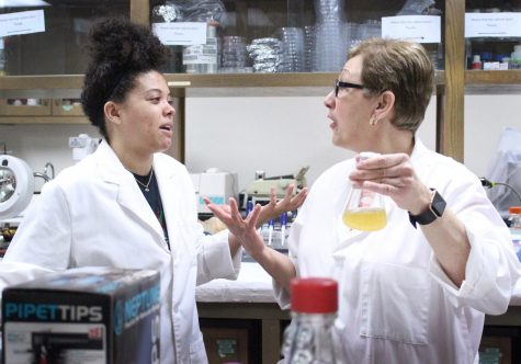 Magaly Rincon-Zachary, biology professor, talks with one of her students, Mi'Kaila Billinger, biology and Spanish junior, about the EURECA reserach project they are working on in the lab, about the results they've gotten so far and possible directions they could go forth with, April 11, 2018. Photo by Rachel Johnson