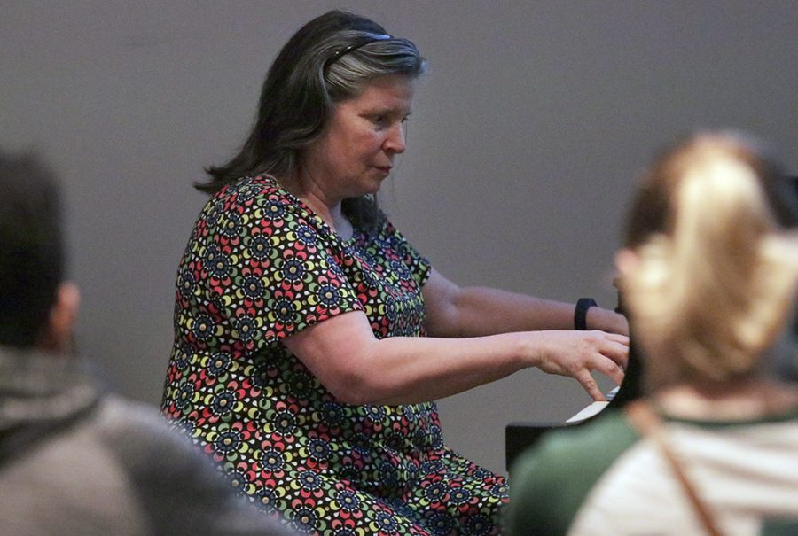 Ruth Morrow, music professor and Bolin distinguished chair of piano, teaches her Tuesday/Thursday 8 a.m.  Introduction to Western and Worl Music, in Fain Fine Arts Center Room C111. Photo by Rachel Johnson