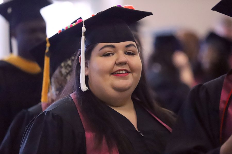 Yolanda Torres, humanities graduate, waits in line to get her name card at the spring 2018 graduation at Kay Yeager Coliseum on May 12, 2018. Photo by Justin Marquart