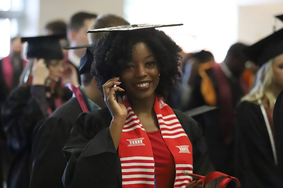Dierrica Smith, mass communication graduate, enters the graduates holding area at the spring 2018 graduation at Kay Yeager Coliseum on May 12, 2018. Photo by Justin Marquart
