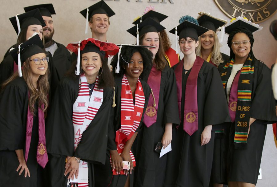 Graduates gather to take a group photo before the Midwestern State University Commencement at Kay Yeager Coliseum on Saturday, May 12, 2018. Photo by Francisco  Martinez